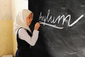 Германия: исторический закон об интеграции беженцев